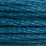 A close-up view of embroidery thread skeins, held taught horizontally. The shade is a deep blue-green, like a swimming pool at night