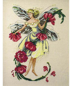 A fairy whose dragonfly wings are full of rivery greens and browns and blues plucks the blooms from a vine of tea roses. Her hair and dress are yellow, and she is crowned with daisies.