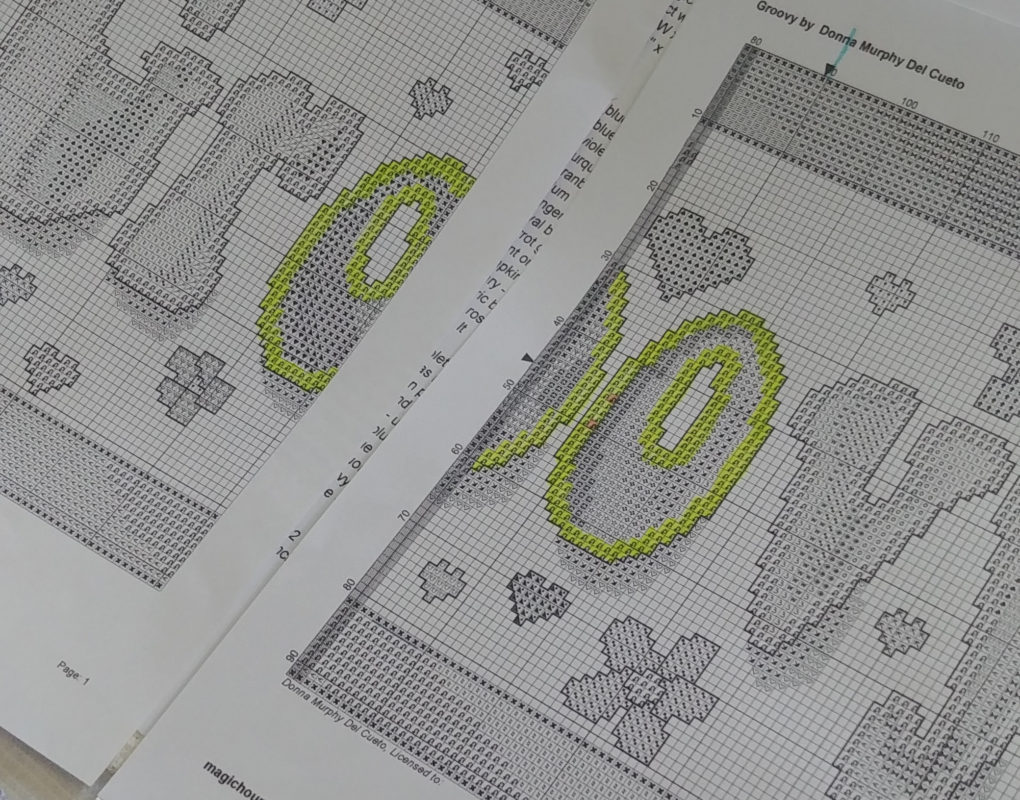 A cross stitch pattern with some squares highlighted in yellow
