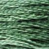 A close-up view of embroidery thread skeins, held taught horizontally. The shade is a of the most commonly used green shades. It's medium, with a hint of greyish undertones, like green mouthwash.