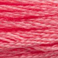 A close-up view of embroidery thread skeins, held taught horizontally. The shade is a pretty medium pink close to the colour of a seedless watermelon