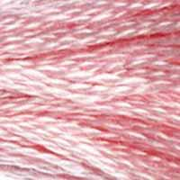 A close-up view of embroidery thread skeins, held taught horizontally. The shade is a medium light pretty pink, a bit stronger than baby pink