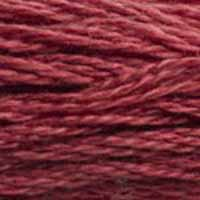 A close-up view of embroidery thread skeins, held taught horizontally. The shade is a medium dark dusty rose with a hint of burgundy