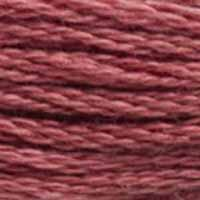 A close-up view of embroidery thread skeins, held taught horizontally. The shade is a medium dusty rose with a hint of burgundy