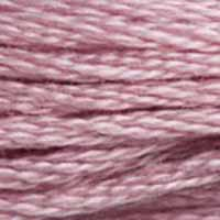 A close-up view of embroidery thread skeins, held taught horizontally. The shade is a light pretty dusty purple