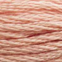 A close-up view of embroidery thread skeins, held taught horizontally. The shade is a light pink with just a touch or brick