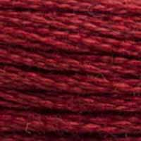 A close-up view of embroidery thread skeins, held taught horizontally. The shade is a dark wine red with a touch or brick, like a nice Merlot