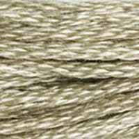 A close-up view of embroidery thread skeins, held taught horizontally. The shade is a medium light greyish brown like coffee with skim milk