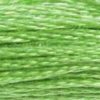 A close-up view of embroidery thread skeins, held taught horizontally. The shade is a bright light green, like the stems of spring flower-crown