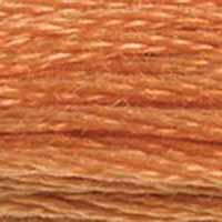 A close-up view of embroidery thread skeins, held taught horizontally. The shade is a medium light, warm orange, like roasted pumpkin