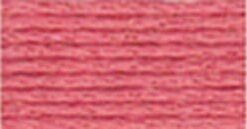 A close-up view of embroidery thread skeins, held taught horizontally. The shade is a rosy, blushing, peach colour
