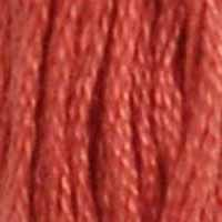 A close-up view of embroidery thread skeins, held taught vertically. The shade is a dark salmon