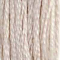 A close-up view of embroidery thread skeins, held taught vertically. The shade is a light cream