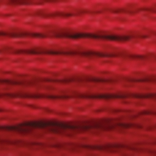 A close-up view of embroidery thread skeins, held taught horizontally. The shade is a medium reddish mahogany colour in six strand cotton floss, like maple leaves in fall.