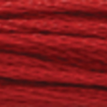 A close-up view of embroidery thread skeins, held taught horizontally. The shade is a very dark tawny red colour in six strand cotton floss, like a ripe beefsteak tomato.