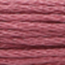 A close-up view of embroidery thread skeins, held taught horizontally. The shade is a medium grayish amethyst colour in six strand cotton floss, like strawberry jam.