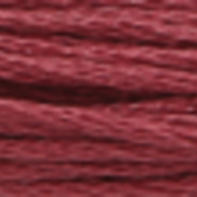 A close-up view of embroidery thread skeins, held taught horizontally. The shade is a very dark grayish amethyst colour in six strand cotton floss, like prune juice.