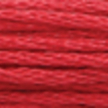 A close-up view of embroidery thread skeins, held taught horizontally. The shade is avery dark dull red colour in six strand cotton floss, like smoked salmon slices.