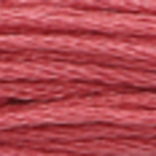 A close-up view of embroidery thread skeins, held taught horizontally. The shade is a medium tawny purple colour in six strand cotton floss, like a glass of rosé.
