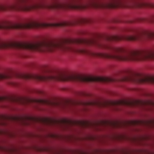 A close-up view of embroidery thread skeins, held taught horizontally. The shade is a dark tawny purple colour in six strand cotton floss, like a ripe plum.