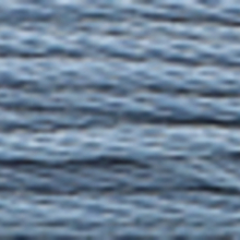 A close-up view of embroidery thread skeins, held taught horizontally. The shade is a dark medium slate blue colour in six strand cotton floss, like the early sky before dawn.