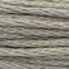 A close-up view of embroidery thread skeins, held taught horizontally. The shade is a medium grey colour in six strand cotton floss, like old silver.