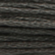 A close-up view of embroidery thread skeins, held taught horizontally. The shade is a very dark charcoal grey colour in six strand cotton floss, like a well-used blackboard.