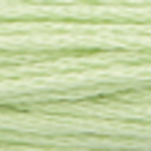 A close-up view of embroidery thread skeins, held taught horizontally. The shade is a very pale greenish off white colour in six strand cotton floss for cross stitch and embroidery