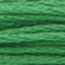 A close-up view of embroidery thread skeins, held taught horizontally. The shade is a  light medium apple green colour in six strand cotton floss, like crème de menthe