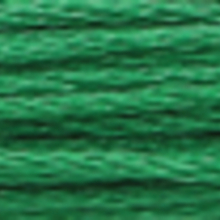 A close-up view of embroidery thread skeins, held taught horizontally. The shade is a dark medium apple green colour in six strand cotton floss, like menthol mouthwash