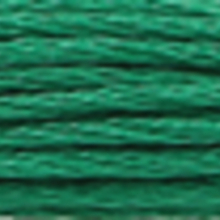 A close-up view of embroidery thread skeins, held taught horizontally. The shade is a  dark apple green colour in six strand cotton floss, like evergreen boughs