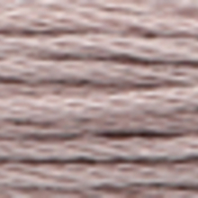 A close-up view of embroidery thread skeins, held taught horizontally. The shade is a medium pale grayish purple colour in six strand cotton floss, like a lead pipe