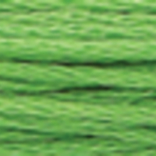 A close-up view of embroidery thread skeins, held taught horizontally. The shade is a medium grass green colour in six strand cotton floss, like a spiked horse chestnut shell.