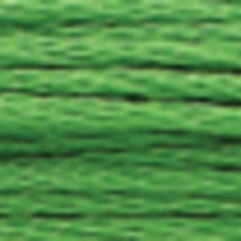 A close-up view of embroidery thread skeins, held taught horizontally. The shade is a dark medium grass green colour in six strand cotton floss, like yew needles