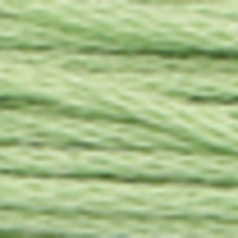 A close-up view of embroidery thread skeins, held taught horizontally. The shade is a very light pale forest green colour in six strand cotton floss, like sun through the leaves