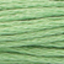 A close-up view of embroidery thread skeins, held taught horizontally. The shade is a very light forest green colour in six strand cotton floss, like dry lichen