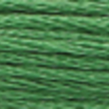 A close-up view of embroidery thread skeins, held taught horizontally. The shade is a medium forest green colour in six strand cotton floss, like spearmint leaves