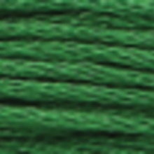 A close-up view of embroidery thread skeins, held taught horizontally. The shade is a dark medium forest green colour in six strand cotton floss, like the astroturf on a mini-putt course.