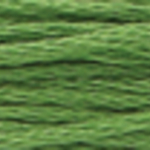 A close-up view of embroidery thread skeins, held taught horizontally. The shade is a dark yellow green colour in six strand cotton floss, like oxalis leaves