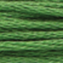 A close-up view of embroidery thread skeins, held taught horizontally. The shade is a very dark yellow green colour in six strand cotton floss, like clover
