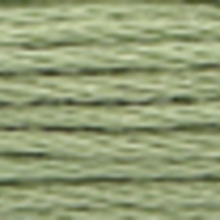 A close-up view of embroidery thread skeins, held taught horizontally. The shade is a light medium grey green colour in six strand cotton floss, like frozen leaves