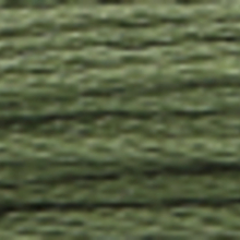 A close-up view of embroidery thread skeins, held taught horizontally. The shade is a dark grey green colour in six strand cotton floss, like a ripe avocado