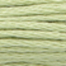 A close-up view of embroidery thread skeins, held taught horizontally. The shade is a very pale evergreen colour in six strand cotton floss, like straw under snow
