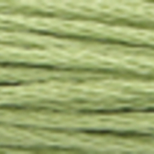 A close-up view of embroidery thread skeins, held taught horizontally. The shade is a pale evergreen colour in six strand cotton floss, like a fresh-cut avocado