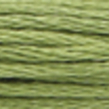 A close-up view of embroidery thread skeins, held taught horizontally. The shade is a medium pale evergreen colour in six strand cotton floss, like wasabi