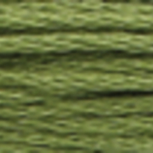 A close-up view of embroidery thread skeins, held taught horizontally. The shade is a medium evergreen colour in six strand cotton floss, like guacamole