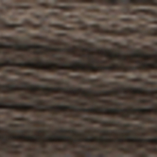 A close-up view of embroidery thread skeins, held taught horizontally. The shade is a dark beaver grey colour in six strand cotton floss, like the bark of an old oak