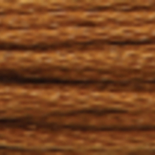 A close-up view of embroidery thread skeins, held taught horizontally. The shade is a cinnamon brown colour in six strand cotton floss, like the polished surface of a chestnut