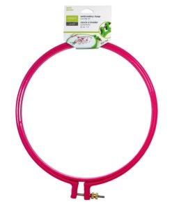 A large plastic embroidery hoop closed with a small metal bolt and screw