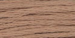 A close-up view of embroidery thread skeins, held taught horizontally. The shade is a tawny brown, like the shore of a swimming hole.